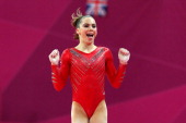 Mc Kayla Maroney of the United States of America celebrates her performance on the vault in the Artistic Gymnastics Women's Team final on Day 4 of...