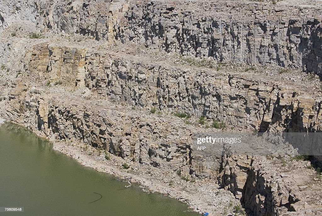 The rocky cliffs of Sue C open pit uranium mine which has been fully exploited and is now being refilled is pictured at Areva Resources 16 July 2007...