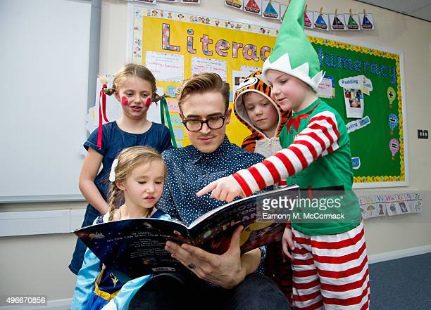 McBusted's Tom Fletcher visits Cranbourne Primary School Winkfield to read from his cowritten book 'The Dinosaur That Pooped a Planet' to launch...