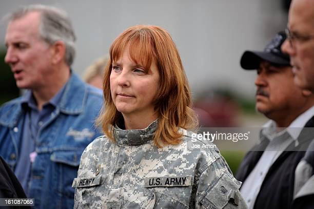 mccainja27a Eva Henry of Thornton stands with a small group of veterans in front of the Alan Gerry Cable Center at the University of Denver Henry's...