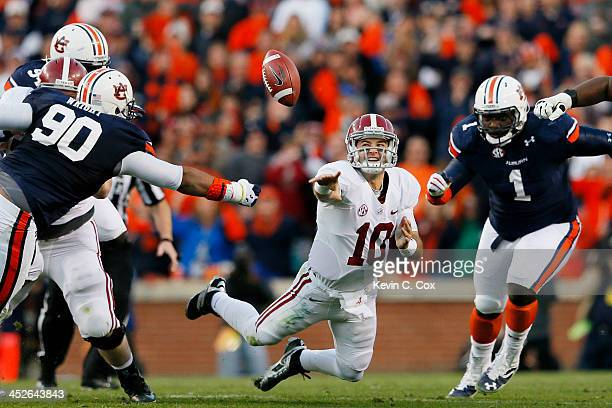 McCarron of the Alabama Crimson Tide attempts a shuttle pass under pressure in the second quarter against the Auburn Tigers at JordanHare Stadium on...