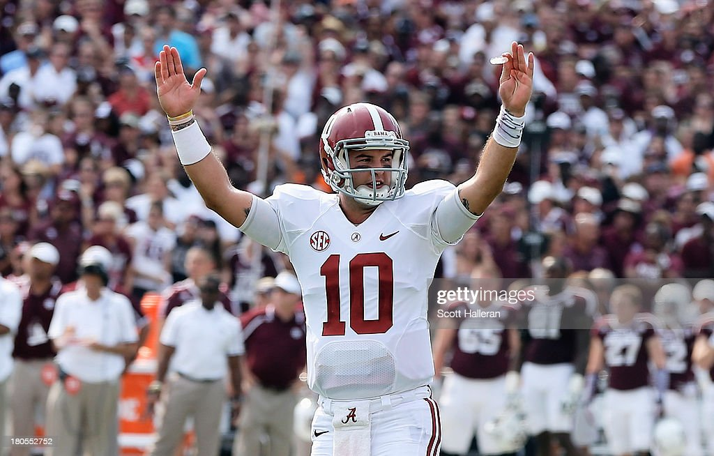 AJ McCarron #10 of the Alabama Crimson Tide celebrates a second quarter touchdown during the game against the Texas A&M Aggies at Kyle Field on September 14, 2013 in College Station, Texas.
