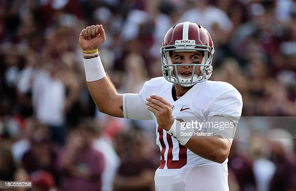 McCarron of the Alabama Crimson Tide celebrates a third quarter touchdown during the game against the Texas AM Aggies at Kyle Field on September 14...