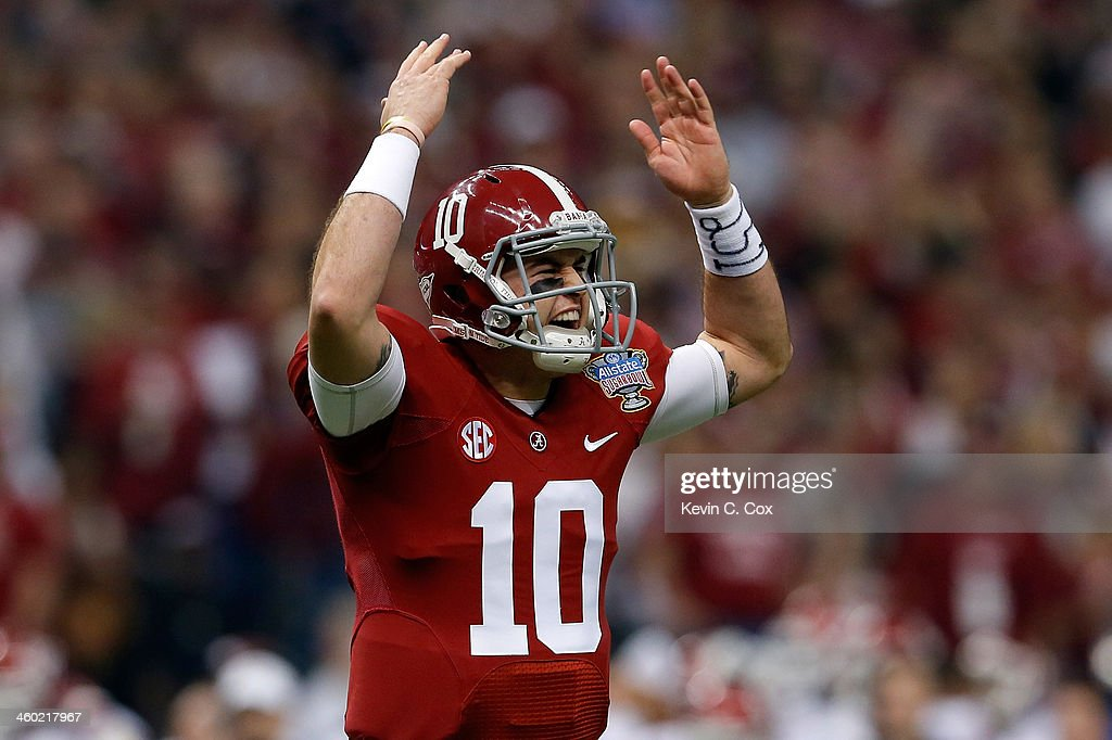 AJ McCarron #10 of the Alabama Crimson Tide celebrates after a touchdown against the Oklahoma Sooners during the Allstate Sugar Bowl at the Mercedes-Benz Superdome on January 2, 2014 in New Orleans, Louisiana.