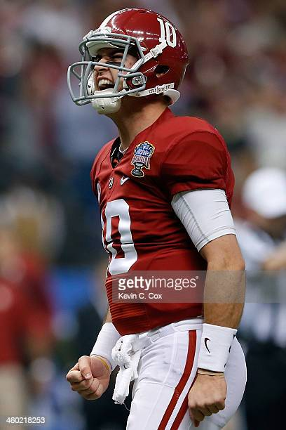 McCarron of the Alabama Crimson Tide celebrates after a touchdown against the Oklahoma Sooners during the Allstate Sugar Bowl at the MercedesBenz...