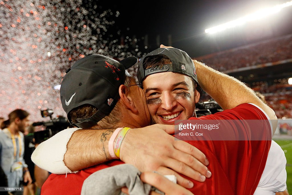 AJ McCarron #10 of the Alabama Crimson Tide celebrates after defeating the Notre Dame Fighting Irish by a score of 42-14 to win the 2013 Discover BCS National Championship game at Sun Life Stadium on January 7, 2013 in Miami Gardens, Florida.