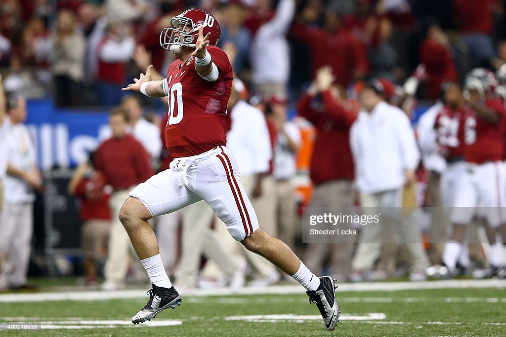AJ McCarron #10 of the Alabama Crimson Tide celebrates after throwing a touchdown pass against the Oklahoma Sooners during the Allstate Sugar Bowl at the Mercedes-Benz Superdome on January 2, 2014 in New Orleans, Louisiana.