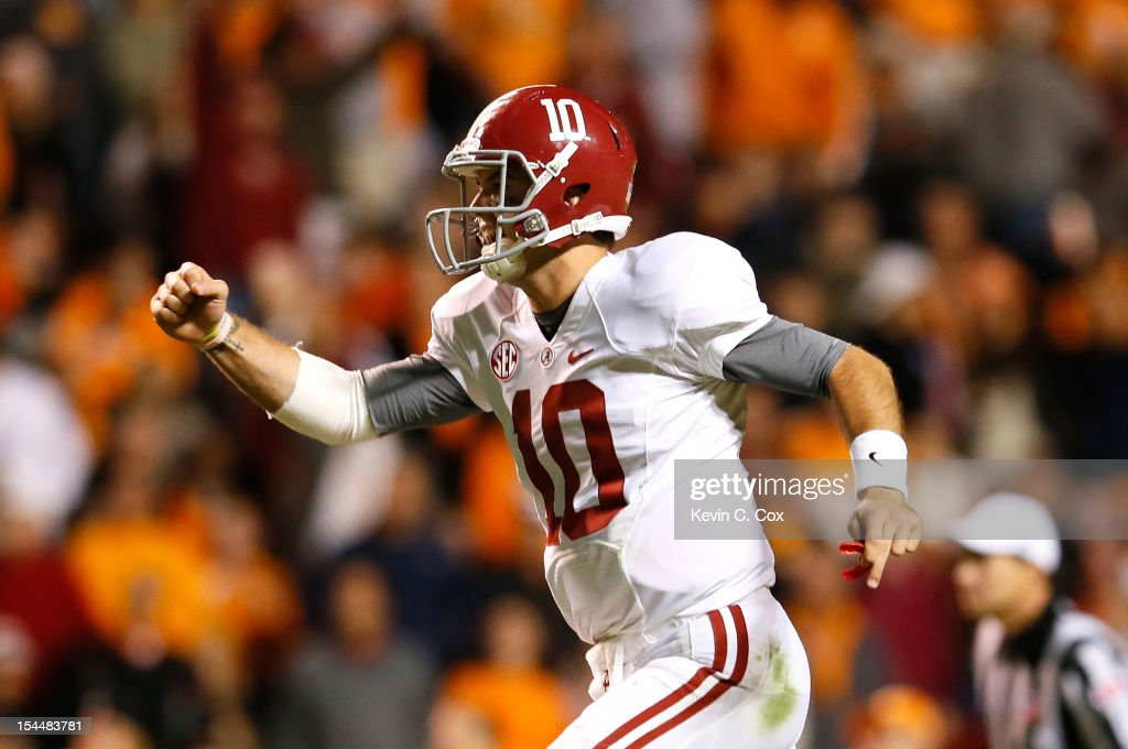 AJ McCarron #10 of the Alabama Crimson Tide celebrates after tossing a touchdown reception against the Tennessee Volunteers at Neyland Stadium on October 20, 2012 in Knoxville, Tennessee.