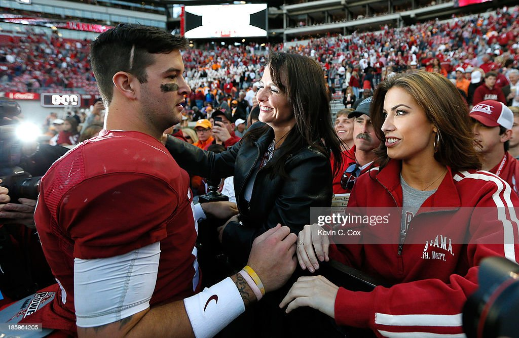 AJ McCarron #10 of the Alabama Crimson Tide celebrates their 45-10 win over the Tennessee Volunteers with mom Dee Dee Bonner and girlfriend Katherine Webb at Bryant-Denny Stadium on October 26, 2013 in Tuscaloosa, Alabama.