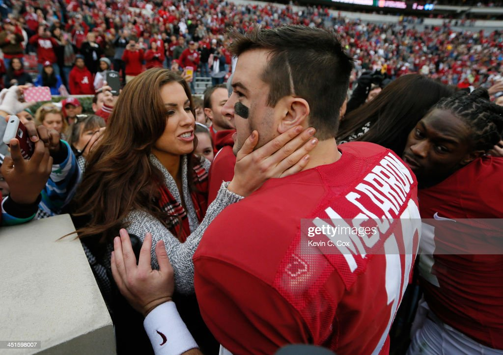 AJ McCarron #10 of the Alabama Crimson Tide celebrates their 49-0 win over the Chattanooga Mocs with his girlfriend Katherine Webb at Bryant-Denny Stadium on November 23, 2013 in Tuscaloosa, Alabama.