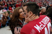 McCarron of the Alabama Crimson Tide celebrates their 490 win over the Chattanooga Mocs with his girlfriend Katherine Webb at BryantDenny Stadium on...