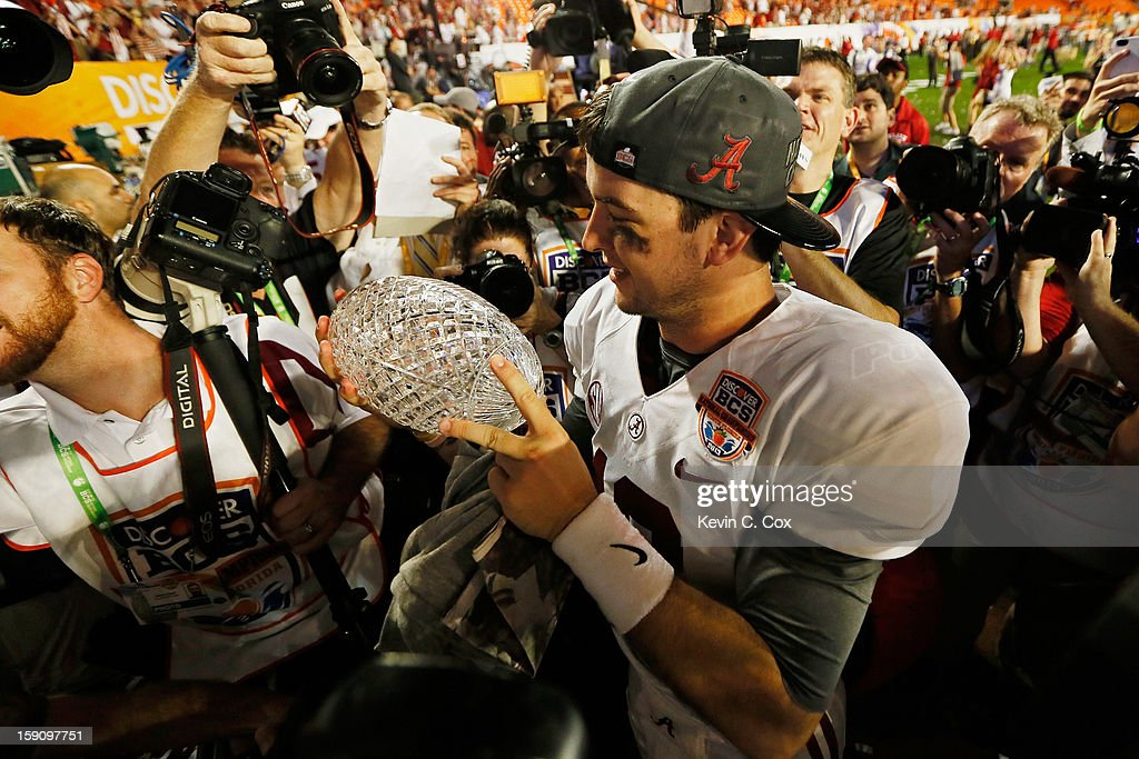 AJ McCarron #10 of the Alabama Crimson Tide celebrates with the Coach's Trophy after defeating the Notre Dame Fighting Irish by a score of 42-14 to win the 2013 Discover BCS National Championship game at Sun Life Stadium on January 7, 2013 in Miami Gardens, Florida.