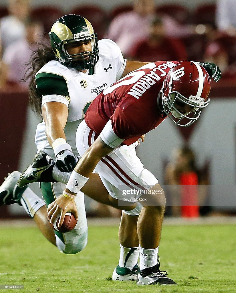 AJ McCarron #10 of the Alabama Crimson Tide is pressured by Eli Edwards #99 of the Colorado State Rams at Bryant-Denny Stadium on September 21, 2013 in Tuscaloosa, Alabama.