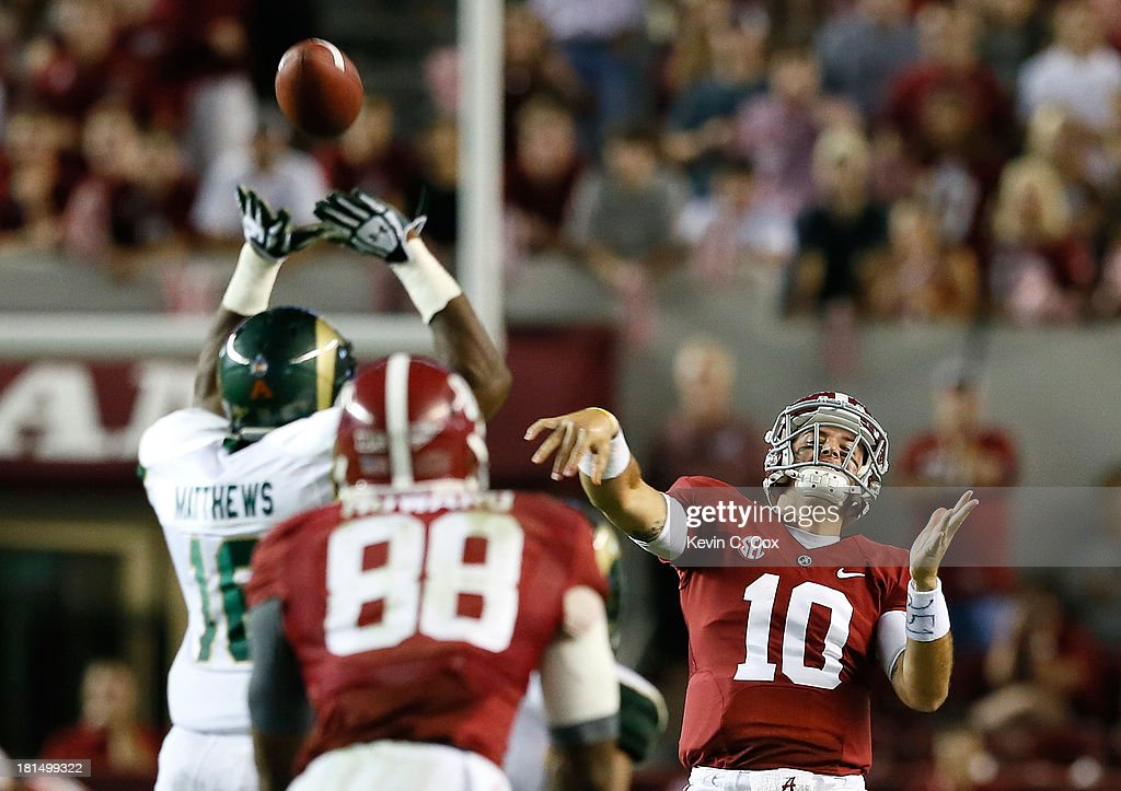 AJ McCarron #10 of the Alabama Crimson Tide passes against the Colorado State Rams after being pressured out of the pocket at Bryant-Denny Stadium on September 21, 2013 in Tuscaloosa, Alabama.