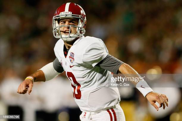 McCarron of the Alabama Crimson Tide reacts after throwing a touchdown in the first quarter to Michael Williams against the Notre Dame Fighting Irish...