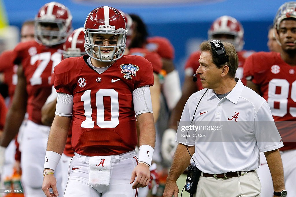 AJ McCarron #10 of the Alabama Crimson Tide talks with head coach <a gi-track='captionPersonalityLinkClicked' href=/galleries/search?phrase=Nick+Saban&family=editorial&specificpeople=242860 ng-click='$event.stopPropagation()'>Nick Saban</a> during a time out against the Oklahoma Sooners during the Allstate Sugar Bowl at the Mercedes-Benz Superdome on January 2, 2014 in New Orleans, Louisiana.