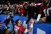 McCarron of the Alabama Crimson Tide talks wtih Katherine Webb after losing to Oklahoma Sooners 4531 during the Allstate Sugar Bowl at the...
