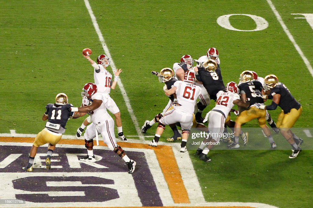 AJ McCarron #10 of the Alabama Crimson Tide throws the ball against the Notre Dame Fighting Irish during the 2013 Discover BCS National Championship Game at Sun Life Stadium on January 7, 2013 in Miami Gardens, Florida. Alabama defeated Notre Dame 42-14.