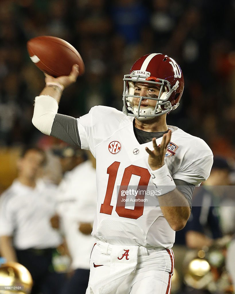 AJ McCarron #10 of the Alabama Crimson Tide throws the ball prior to the game against the Notre Dame Fighting Irish during the 2013 Discover BCS National Championship Game at Sun Life Stadium on January 7, 2013 in Miami Gardens, Florida. Alabama defeated Notre Dame 42-14.