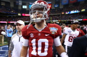 McCarron of the Alabama Crimson Tide walks off the field after the Allstate Sugar Bowl at the MercedesBenz Superdome on January 2 2014 in New Orleans...