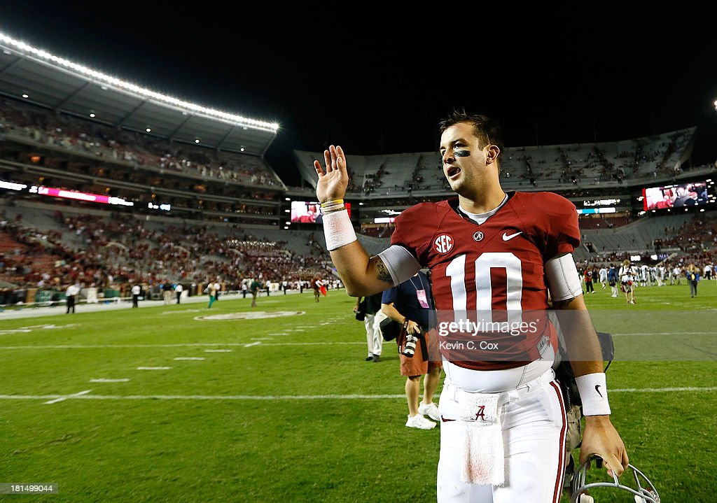 AJ McCarron #10 of the Alabama Crimson Tide walks off the field after their 31-6 win over the Colorado State Rams at Bryant-Denny Stadium on September 21, 2013 in Tuscaloosa, Alabama.