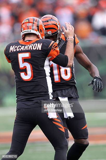 McCarron of the Cincinnati Bengals congratulates AJ Green of the Cincinnati Bengals after catching a pass for a touchdown during the third quarter of...