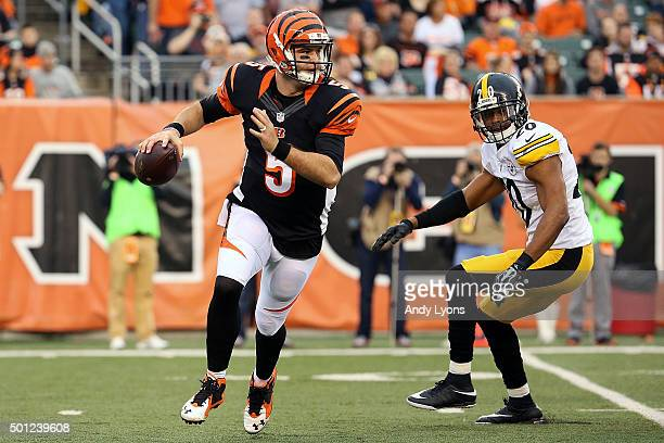 McCarron of the Cincinnati Bengals scrambles while looking to throw the ball during the third quarter of the game against the Pittsburgh Steelers at...
