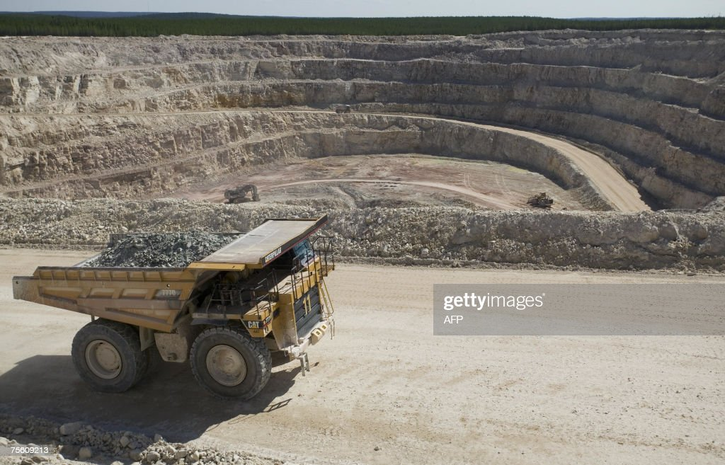 A onehundred ton Caterpillar truck carries ore from the Sue E open pit uranium mine at Areva Resources 16 July 2007 in McClean Lake Canada Twenty...
