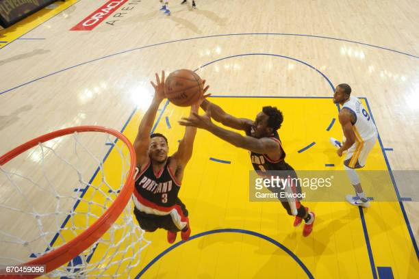 McCollum and AlFarouq Aminu of the Portland Trail Blazers go for the rebound against the Golden State Warriors during the Western Conference...