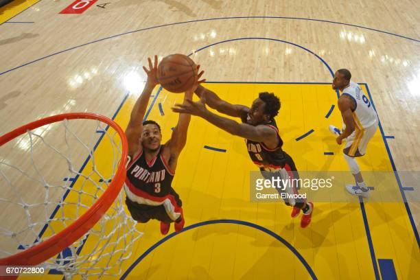 J McCollum and AlFarouq Aminu of the Portland Trail Blazers go up for a rebound against the Golden State Warriors during the Western Conference...