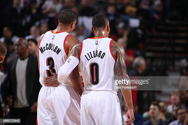 J McCollum and Damian Lillard of the Portland Trail Blazers discuss the game plan against the New Orleans Pelicans on October 28 2015 at the Moda...