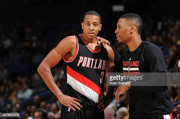 CJ McCollum and Damian Lillard of the Portland Trail Blazers during a game against the Los Angeles Lakers at the Citizens Business Bank Arena in...