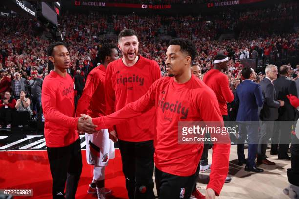J McCollum and Jusuf Nurkic of the Portland Trail Blazers run out before Game Three of the Western Conference Quarterfinals against the Golden State...