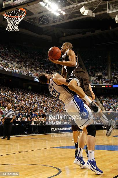 J McCollum of the Lehigh Mountain Hawks goes up for a shot against Miles Plumlee of the Duke Blue Devils during the second round of the 2012 NCAA...