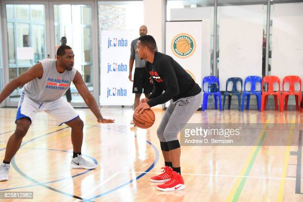 J McCollum of the Portland Trail Blazers against Elton Brand goes through a workout as part of Basketball Without Borders Africa at the American...