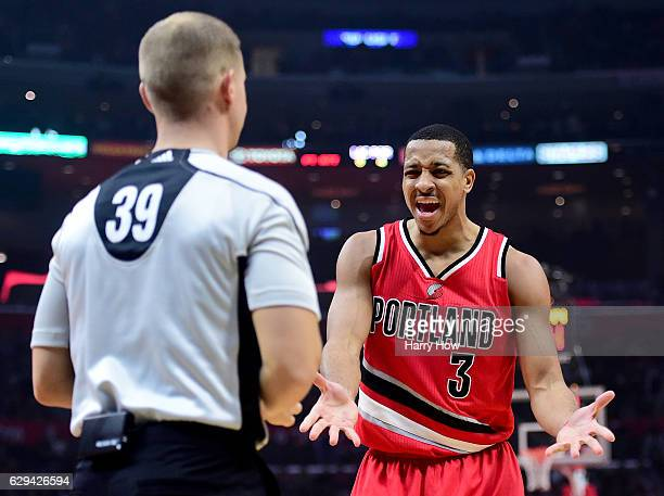 J McCollum of the Portland Trail Blazers argues a foul call with referee Tyler Ford during the first half against the LA Clippers at Staples Center...