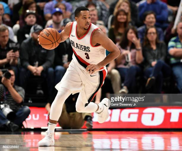 McCollum of the Portland Trail Blazers brings the ball up court in the second half of their 112103 overtime loss to the Utah Jazz at Vivint Smart...