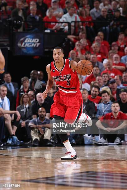 J McCollum of the Portland Trail Blazers brings the ball up court against the Memphis Grizzlies in Game Three of the Western Conference Quarterfinals...
