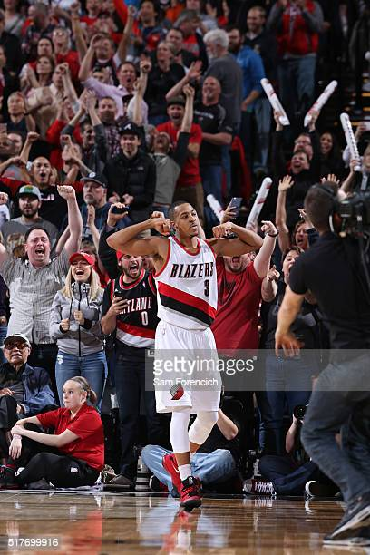 J McCollum of the Portland Trail Blazers celebrates after hitting the game winning shot against the Philadelphia 76ers on March 26 2016 at the Moda...