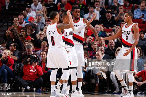 J McCollum of the Portland Trail Blazers celebrates with his teammates during a game against the Phoenix Suns on November 8 2016 at the Moda Center...