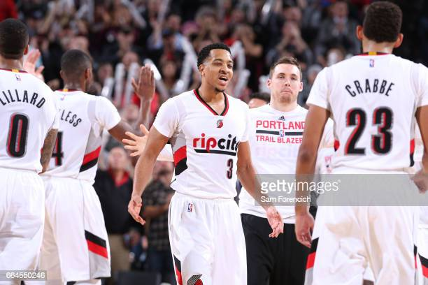 McCollum of the Portland Trail Blazers celebrates with his teammates during the game against the Houston Rockets on March 30 2017 at the Moda Center...