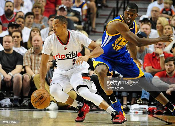 J McCollum of the Portland Trail Blazers dribbles away from Harrison Barnes of the Golden State Warriors in the first quarter of Game Three of the...