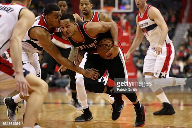 J McCollum of the Portland Trail Blazers dribbles in front of Otto Porter Jr #22 of the Washington Wizards during the first half at Verizon Center on...