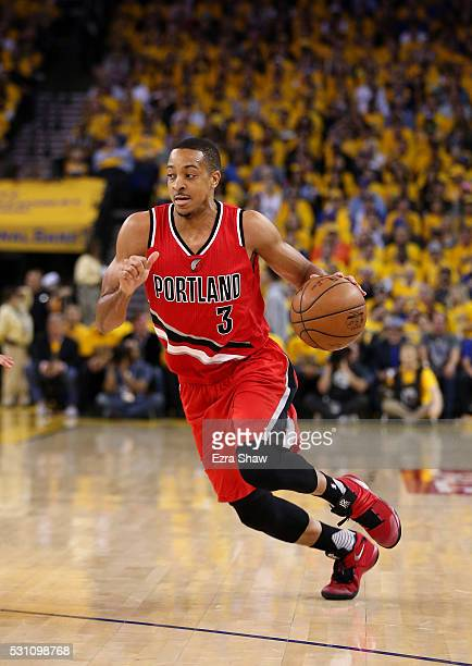 J McCollum of the Portland Trail Blazers dribbles the ball against the Golden State Warriors during Game Five of the Western Conference Semifinals...