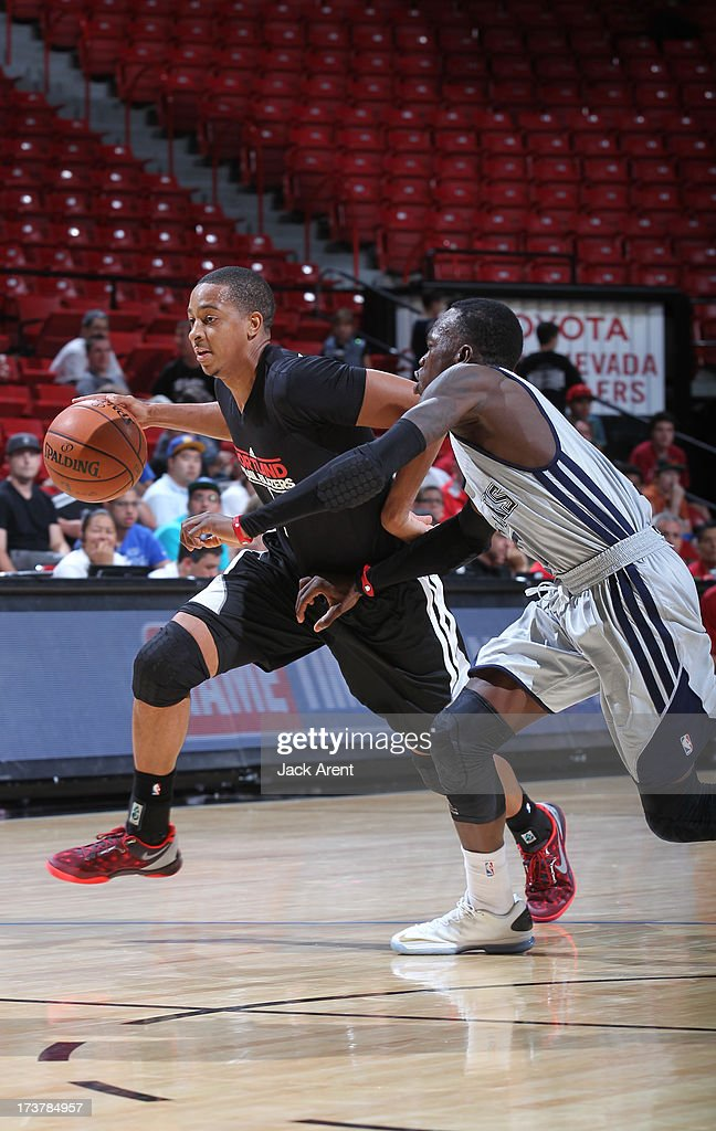 CJ McCollum #3 of the Portland Trail Blazers drives against Dennis Schroder #17 of the Atlanta Hawks during the NBA Summer League game between the Atlanta Hawks and the Portland Trail Blazers on July 17, 2013 at the Thomas & Mack Center in Las Vegas, Nevada.