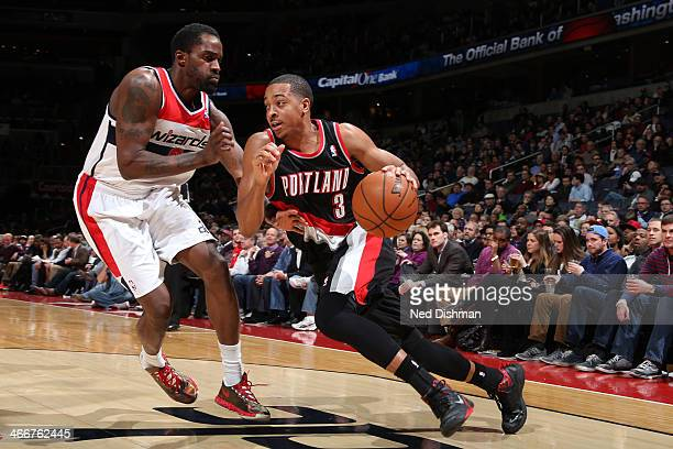J McCollum of the Portland Trail Blazers drives against Martell Webster of the Washington Wizards during the game at the Verizon Center on February 3...