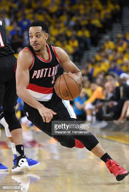 McCollum of the Portland Trail Blazers drives to the basket against the Golden State Warriors in the fourth quarter during Game One of the first...