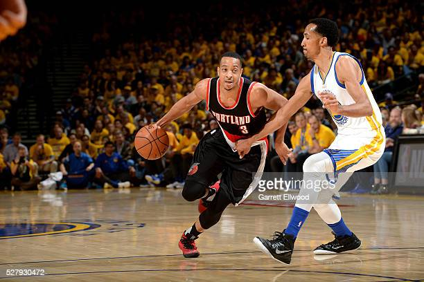 J McCollum of the Portland Trail Blazers drives to the basket during the game against Shaun Livingston of the Golden State Warriors in Game Two of...