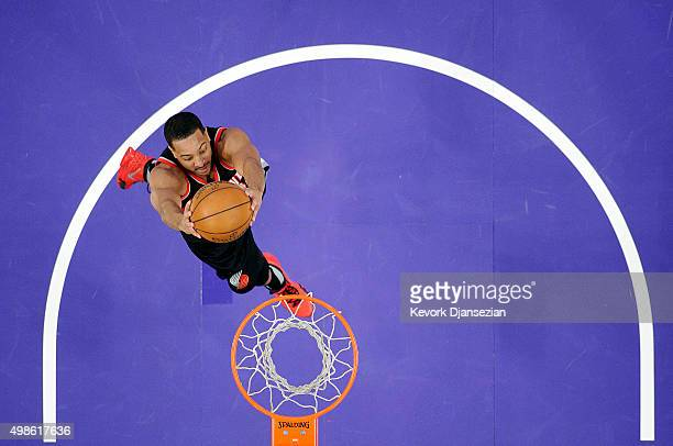 J McCollum of the Portland Trail Blazers glides for a dunk against the Los Angeles Lakers during the second half of the basketball game at Staples...