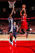 CJ McCollum of the Portland Trail Blazers goes for the layup against the Memphis Grizzlies during Game Three of the Western Conference Quarterfinals...